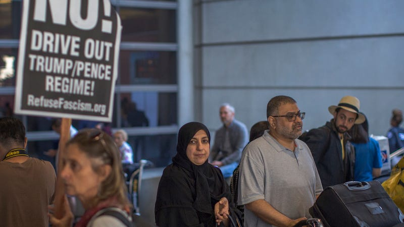 Arriving international travelers pass protesters on the first day of the the partial reinstatement of the Trump travel ban, temporarily barring travelers from six Muslim-majority nations from entering the U.S., at Los Angeles International Airport (LAX) on June 29, 2017 in Los Angeles, California.