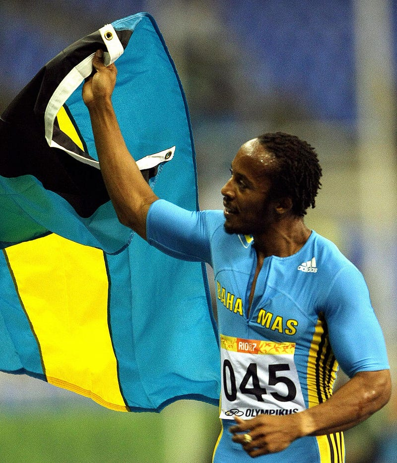The Bahamas' Chris Brown waves his national flag to celebrate the 400-meter gold medal in the Pan American Games in Rio de Janeiro on July 25, 2007.ANTONIO SCORZA/AFP/Getty Images