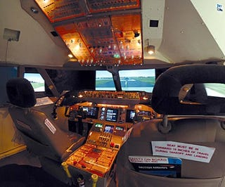 Man Builds $30,000 Jumbo Jet Simulator in his Bedroom