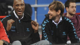 Lamar Odom (left), while playing in Spain's basketball league, attends a game in Vitoria-Gasteiz, Spain, Feb. 20, 2014.RAFA RIVAS/AFP/Getty Images
