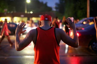 Demonstrators gather along West Florissant Avenue to protest the shooting of Michael Brown on August 15, 2014 in Ferguson, Missouri. Photo by Scott Olson/Getty Images