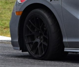 Illustration for article titled Identify the race car going into turn 10B at Road Atlanta.