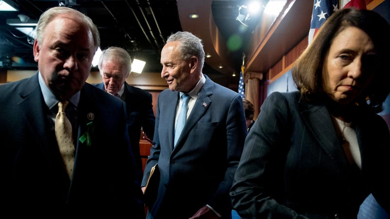 Rep. Mike Doyle, Sen. Ed Markey, Sen. Chuck Schumer, and Sen. Maria Cantwell, leave a news conference on Capitol Hill after the Senate passed a resolution to reverse the FCC decision to end net neutrality.