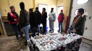 Flint residents line up to get bottled water, water testing kits and water filters at a Flint Fire Station Jan. 13, 2016, in Flint, Mich.Bill Pugliano/Getty Images