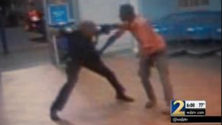 Surveillance video that appears to show an off-duty police officer working as a security guard at an Atlanta Wal-Mart beating Tyrone Carnegay with a batonWSB-TV Screenshot