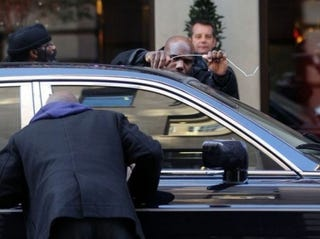 Illustration for article titled Caption This:  50 Cent's Rolls Royce Holds Its Own Key Hostage