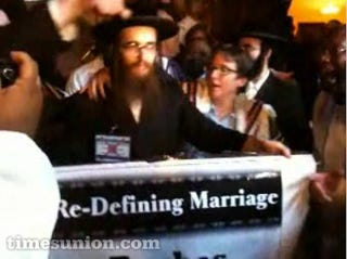Illustration for article titled Ultra-Orthodox Man Spits On Lesbian Rabbi At Gay Marriage Protest