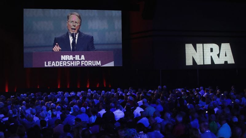 The NRA's Wayne LaPierre rails against liberals with their safe spaces and Orwellian propaganda from a giant screen overlooking a gun convention, (Photo: Scott Olson/Getty)