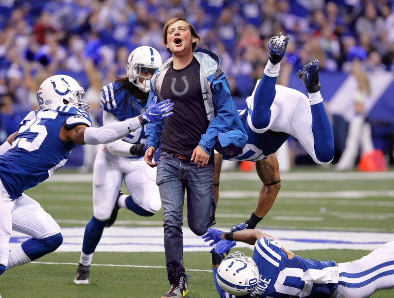 Illustration for article titled Colts Miss 8 Tackles On Drunken Fan Running Across Field