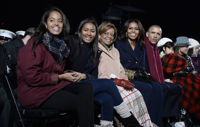 The first family—Malia Obama; Sasha Obama; the president's mother-in-law, Marian Robinson; first lady Michelle Obama; and President Barack Obama—attend the National Christmas Tree Lighting Ceremony at the White House on Dec. 3, 2015, in Washington, D.C.Olivier Douliery-Pool/Getty Images