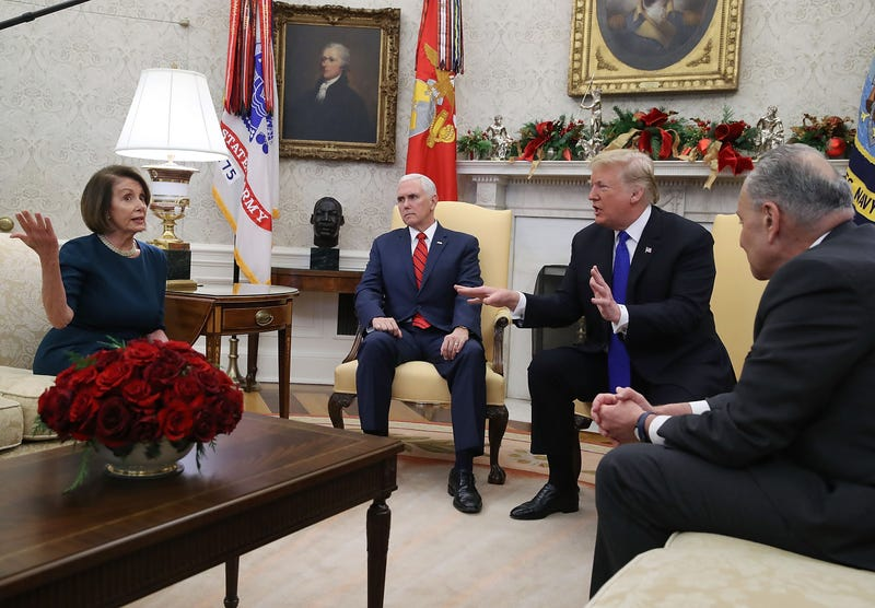 Donald Trump (2R) argues about border security with Senate Minority Leader Chuck Schumer (D-NY) (R) and House Minority Leader Nancy Pelosi (D-CA) as Vice President Mike Pence sits nearby in the Oval Office on December 11, 2018 in Washington, DC.