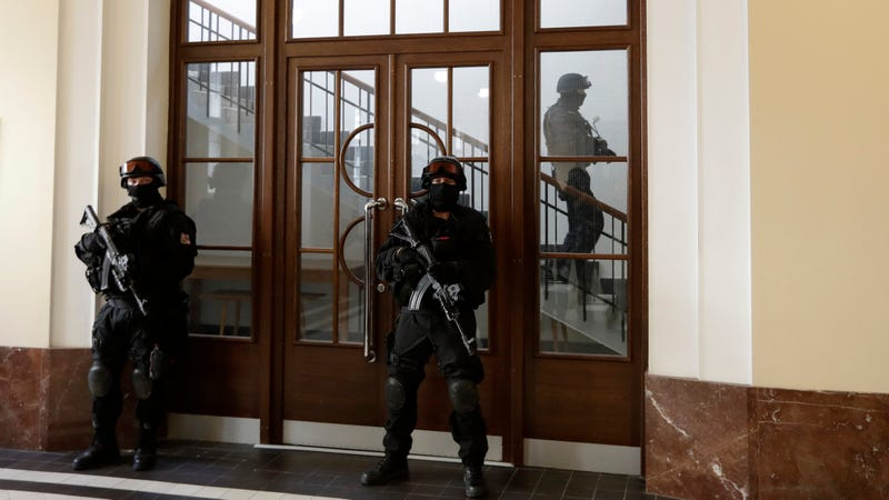 Prison guards walks outside a courtroom during an appeal by Yevgeniy Nikulin from Russia who faces charges of hacking computers of American companies on Nov. 24, 2017, in Prague, Czech Republic
