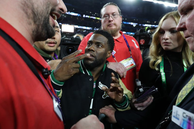 Comedian and Philidelphia native Kevin Hart attempts to get onto the stage following the Eagles 41-33 win over the New England Patriots in Super Bowl LII at U.S. Bank Stadium on February 4, 2018 in Minneapolis, Minnesota. (Elsa/Getty Images)