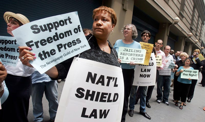 Dana Canedy (center), then a New York Times assignment editor for national news, and other members of the Newspaper Guild of New York protest in support of Time magazine reporter Matthew Cooper and New York Times reporter Judith Miller outside New York Times headquarters July 6, 2005, in New York City. Canedy is leaving the Times in part to work on the movie adaptation of her book, A Journal for Jordan. Mario Tama/Getty Images)