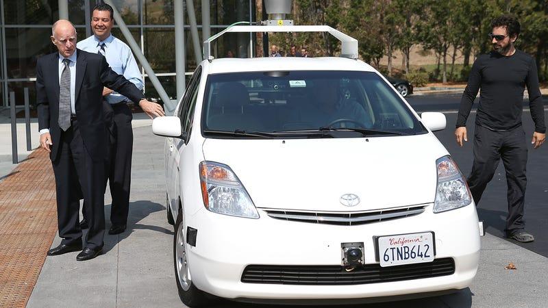 California Gov. Jerry Brown signs legislation permitting testing of autonomous in 2012. Nope! Photo via Getty.
