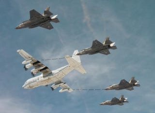 Illustration for article titled These photos of four F-35s refueling in the air are so amazing