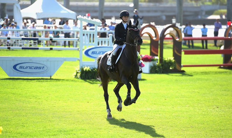Georgina Bloomberg competing at Donald Trump's Mar-a-Largo Club in 2015. Image via Getty.