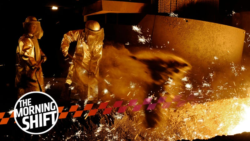 In this Dec. 10, 2008 file photo steelworker of German steel company Salzgitter AG are seen on a furnace in Salzgitter, Germany.