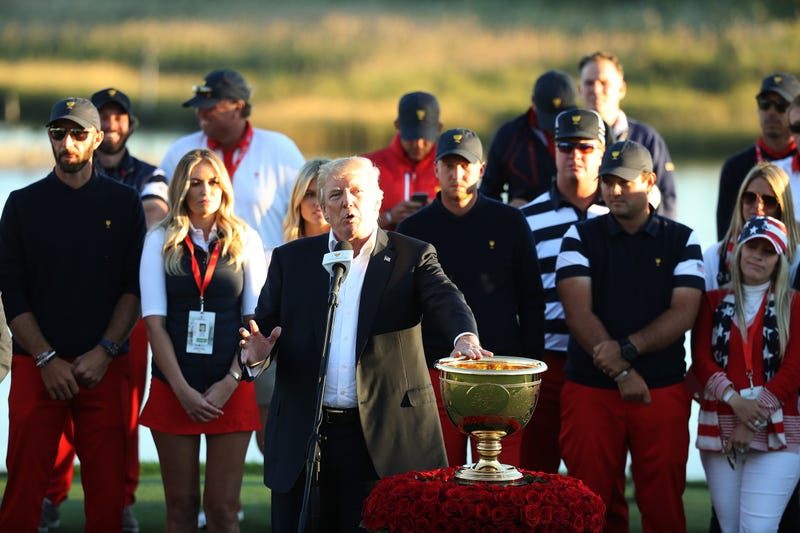 President Donald Trump presents the U.S. Team with the trophy after their victory against the International Team in the Presidents Cup at Liberty National Golf Club on Oct. 1, 2017, in Jersey City, N.J. (Rob Carr/Getty Images)