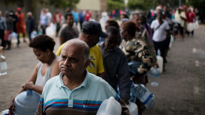Residents line up to fill containers with water in Cape Town, South Africa. Photo: AP
