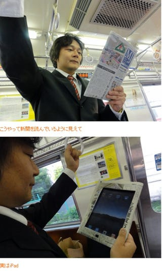 Illustration for article titled Japanese Subway iPad Users Use Ingenious Trick To Hide iPad Shame
