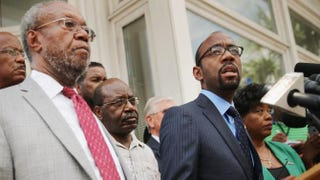 NAACP National President and CEO Cornell Brooks (right) joins the Rev. Joseph Darby and other local and state association leaders for a news conference about the shooting at the historic Emanuel African Methodist Episcopal Church outside the local branch offices June 19, 2015, in Charleston, S.C.Chip Somodevilla/Getty Images