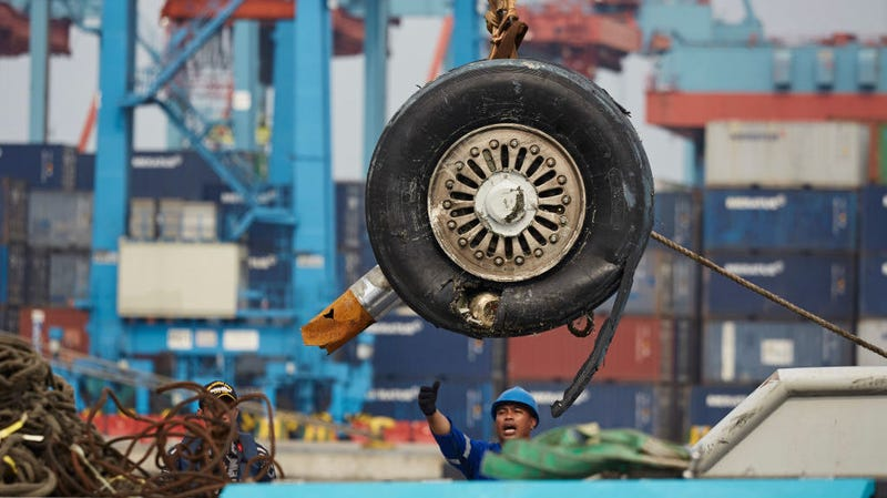 The wrecked landing gear of Lion Air Flight JT 610 is unloaded from a ship at the Tanjung Priok port on November 3, 2018 in Jakarta, Indonesia.