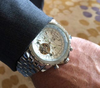 Illustration for article titled Kliff Kingsbury's Swaggy And Expensive-Looking Watch Is Probably Fake