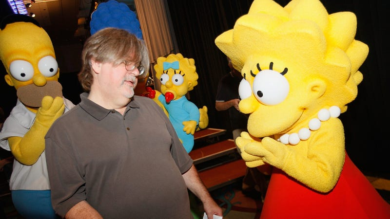 Matt Groening is the one wearing glasses