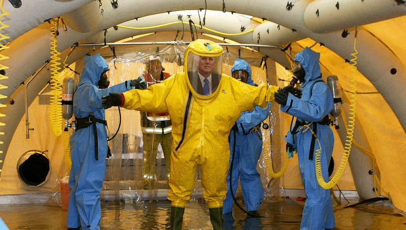 Illustration for article titled 'It's Not So Bad,' Mike Pence Reports On Conditions Of Detainment Center While Hazmat Suit Disinfected
