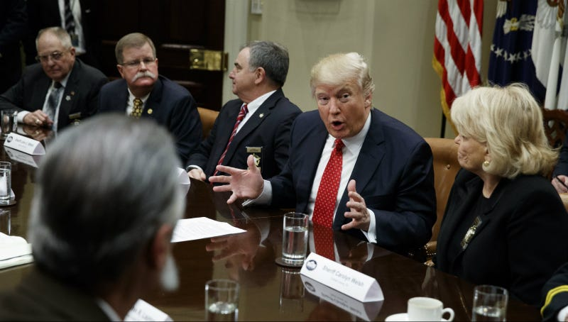 Trump meets with the sheriff's in the Roosevelt Room. Photo via AP