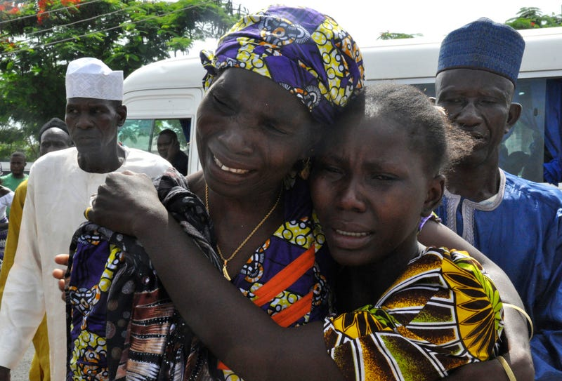 A woman embraces a relative, one of the released schoolgirls kidnapped by Boko Haram, in Abuja, Nigeria, on May 20, 2017. (Olamikan Gbemiga/AP Images)