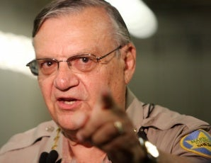 Sheriff Arpaio has three fingers pointing back at himself. (Google)