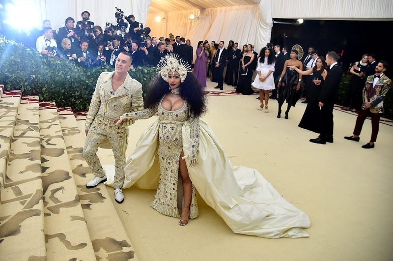 Designer Jeremy Scott and recording artist Cardi B attend the Heavenly Bodies: Fashion & The Catholic Imagination Costume Institute Gala at The Metropolitan Museum of Art on May 7, 2018 in New York City.