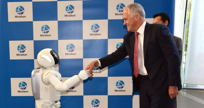 Illustration for article titled With a Handshake and Selfie, Another World Leader Surrenders to the Robots