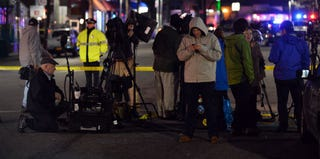 Journalists stand at closed-off neighborhood as cops close in on second Boston bombing suspect. (Stan Honda/Getty Images)