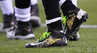 Illustration for article titled Marshawn Lynch's Skittles Sneakers Give Him Superpowers