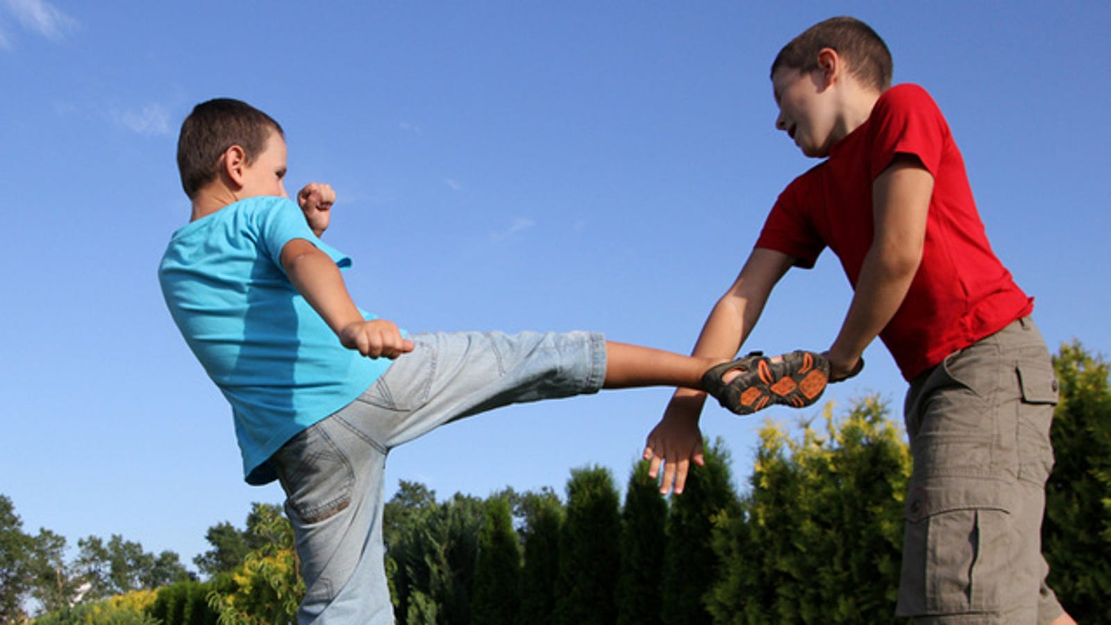 Girl kicking boy in balls