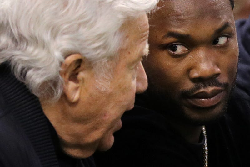 New England Patriots owner Robert Kraft talks with rapper Meek Mill talks during Game 2 of the Eastern Conference second round of the 2018 NBA playoffs between the Boston Celtics and the Philadelphia 76ers in Boston on May 3, 2018.