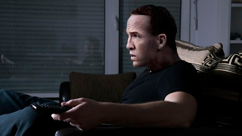 Illustration for article titled Peyton Manning Tirelessly Studying Footage Of Athletes Denying Allegations
