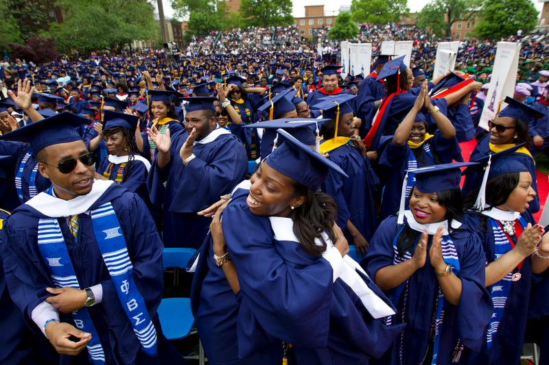 Avielle D. Watkins give a hug to a fellow student as members of the Class of 2014 celebrate during the graduation ceremony at Howard University in Washington, D.C., on May 10, 2014.
