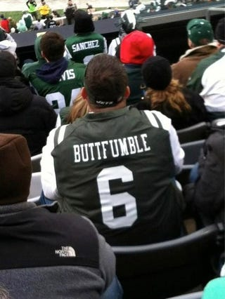 "Illustration for article titled Jets Fan Breaks Out The Mark Sanchez ""Buttfumble"" Jersey"