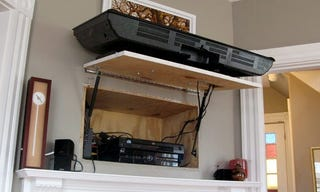... door on your entertainment center to hide your cables and accessories,  architect Dan Herchenroether shows us how to hide them behind a wall  mounted TV, ...