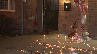 A memorial is lit in honor of 6-year-old Ja'Mecca Smith, who police believe accidentally shot herself in Atlanta on Nov. 28, 2015.WXIA-TV screenshot