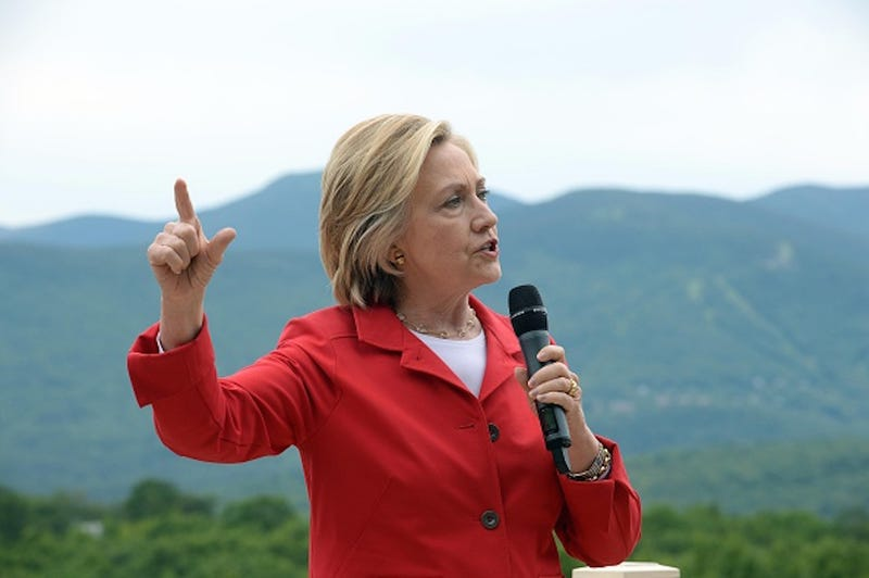 Illustration for article titled Hillary Clinton Campaigns in New Hampshire, Corrals Press With Rope