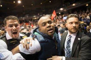 An activist is removed by police after it was announced that a rally with Republican presidential candidate Donald Trump at the University of Illinois at Chicago would be postponed on March 11, 2016, in Chicago.Scott Olson/Getty Images