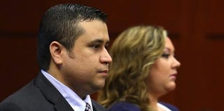 George Zimmerman with Shellie Zimmerman (Pool/Getty Images)