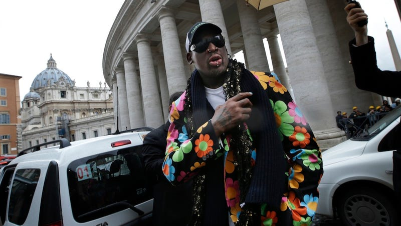 Illustration for article titled Why Is Dennis Rodman At The Vatican? He's Being Paid By A Betting Company, Of Course