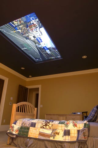 Illustration for article titled Exemplary Mom Builds 98-Inch Screen Inside Kid's Bedroom Ceiling