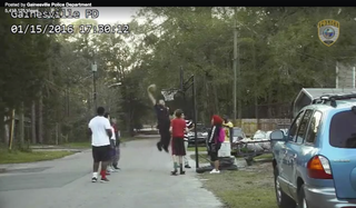 Police Officer Bobby Whites dunks a basketball while playing with neighborhood kids in Gainesville, Fla., Jan. 15, 2016.Gainesville Police Department via Facebook